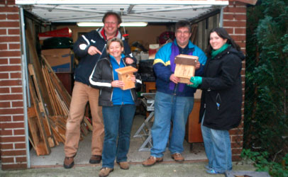 Volunteers with nestboxes